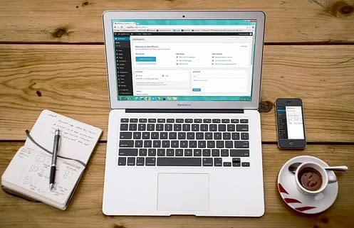 Laptop with WordPress Dashboard on screen