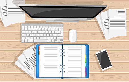 Computer and notebook on desktop