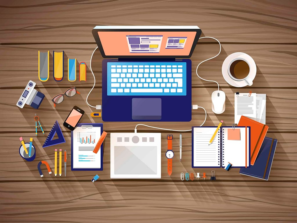 Laptop and work supplies on desk